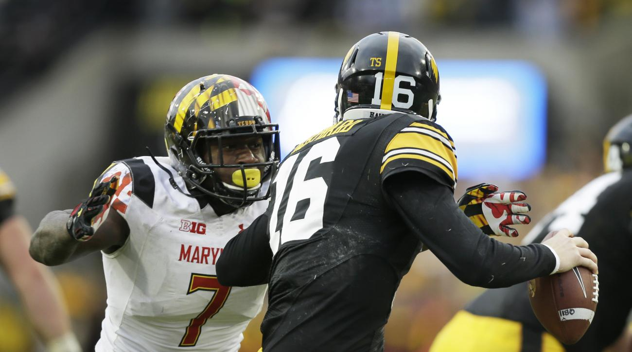 In this Saturday, Oct. 31, 2015, photo, Maryland defensive lineman Yannick Ngakoue, left, chases Iowa quarterback C.J. Beathard during the second half of an NCAA college football game, in Iowa City, Iowa. After doing a decent job stopping the run against