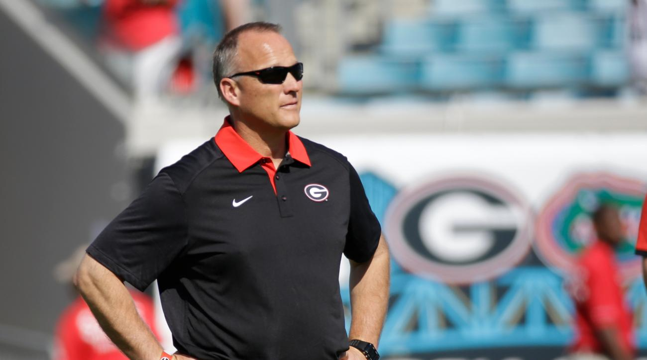 FILE - In this Oct. 31, 2015, file photo, Georgia head coach Mark Richt watches his team warm up before an NCAA college football game against Florida, in Jacksonville, Fla. Losses in three of four games, including last week's ugly loss at Florida, have tu