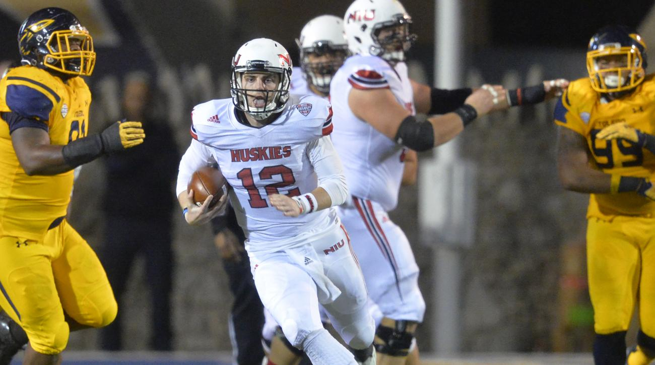 Northern Illinois quarterback Drew Hare (12) scrambles for a first down during the second quarter of an NCAA college football game against Toledo on Tuesday, Nov. 3, 2015, in Toledo, Ohio. (AP Photo/David Richard)