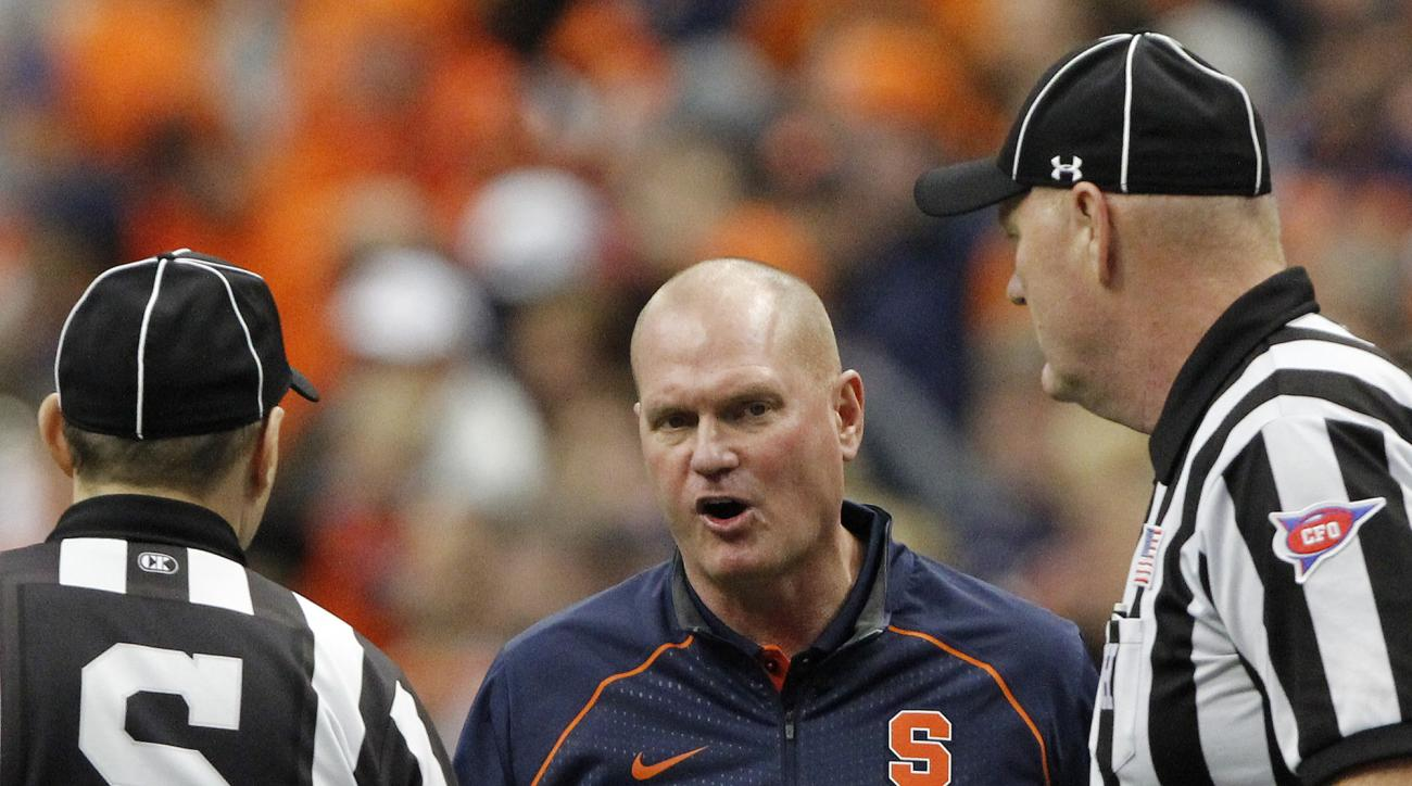FILE - In this Oct. 24, 2015, file photo, Syracuse head coach Scott Shafer talks with officials about a play in the second quarter of an NCAA college football game against Pittsburgh in Syracuse, N.Y. The ACC has a system in place for coaches to help moni