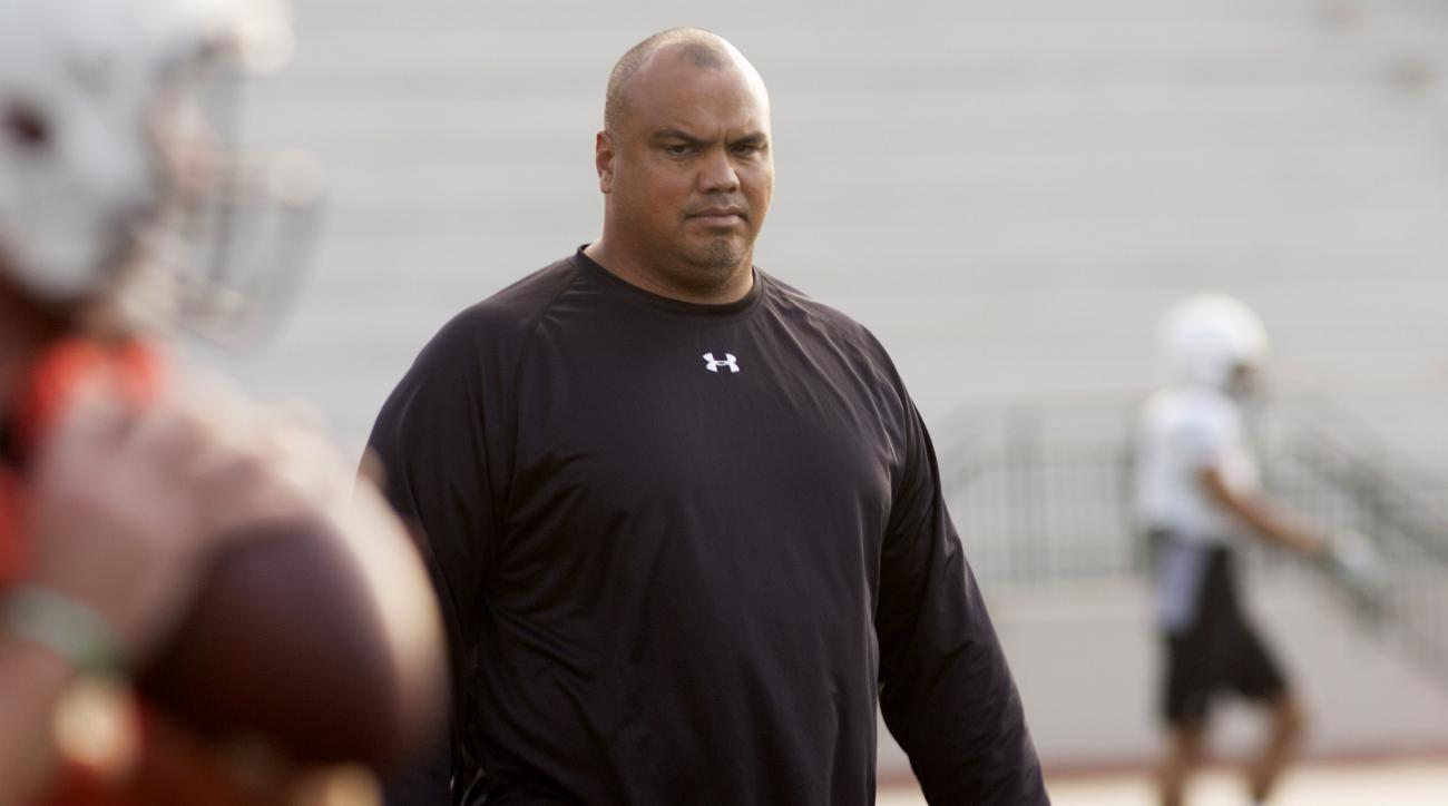 University of Hawaii interim head coach Chris Naeole attends a college football practice on Wednesday, Nov. 4, 2015 in Honolulu. Naeole met with the media Wednesday for the first time since taking over the team following Norm Chow's firing on Sunday. Chow