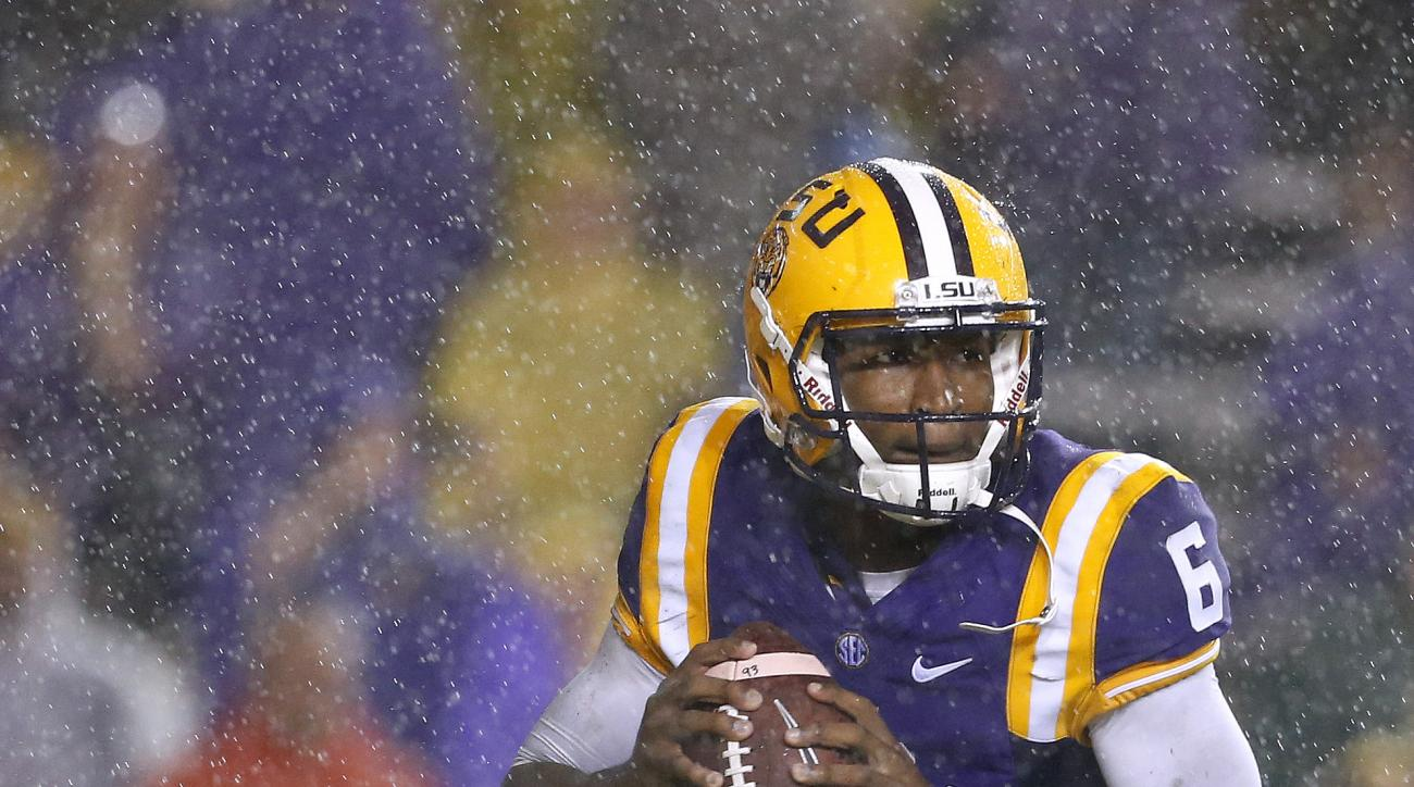 FILE - In this Oct. 24, 2015, file photo,LSU quarterback Brandon Harris (6) looks to pass during the first half an NCAA college football game against Western Kentucky in Baton Rouge, La. LSU quarterback Brandon Harris and Alabama's Jake Coker are largely