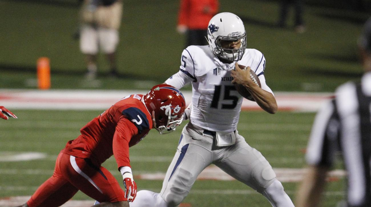Nevada''s Tyler Stewart runs away from Fresno State's Jamal Ellis during the first half of an NCAA college football game in Fresno, Calif., Thursday, Nov. 5, 2015. (AP Photo/Gary Kazanjian)