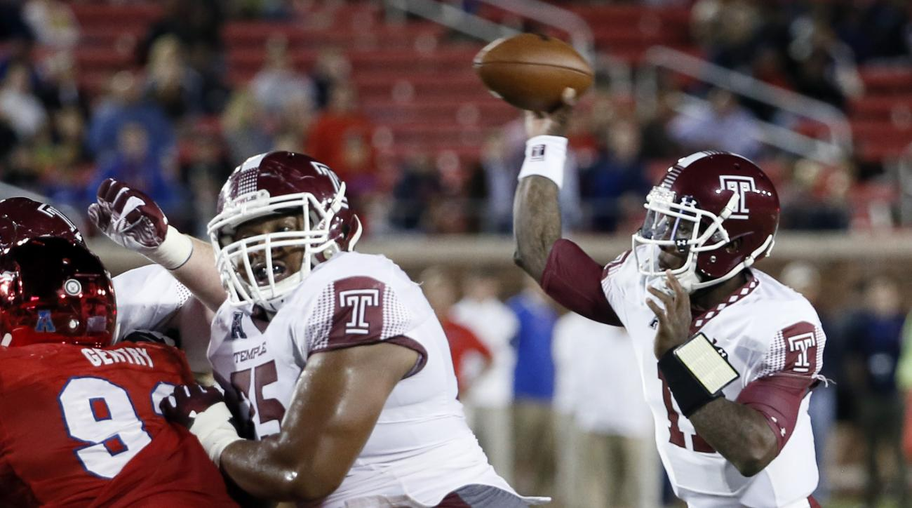 Temple quarterback P.J. Walker (11) throws a pass behind protection from his line in the first half of an NCAA college football game against SMU, Friday, Nov. 6, 2015, in Dallas. (AP Photo/Tony Gutierrez)
