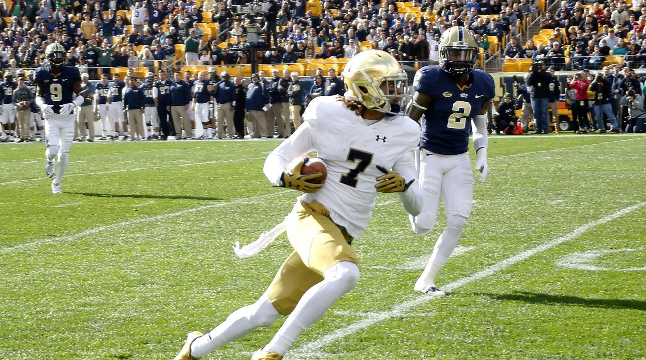 Notre Dame wide receiver Will Fuller (7) runs past Pittsburgh defensive back Terrish Webb (2) after making a catch and running it for a touchdown in the first quarter of an NCAA football game, Saturday, Nov. 7, 2015, in Pittsburgh. (AP Photo/Keith Srakoci
