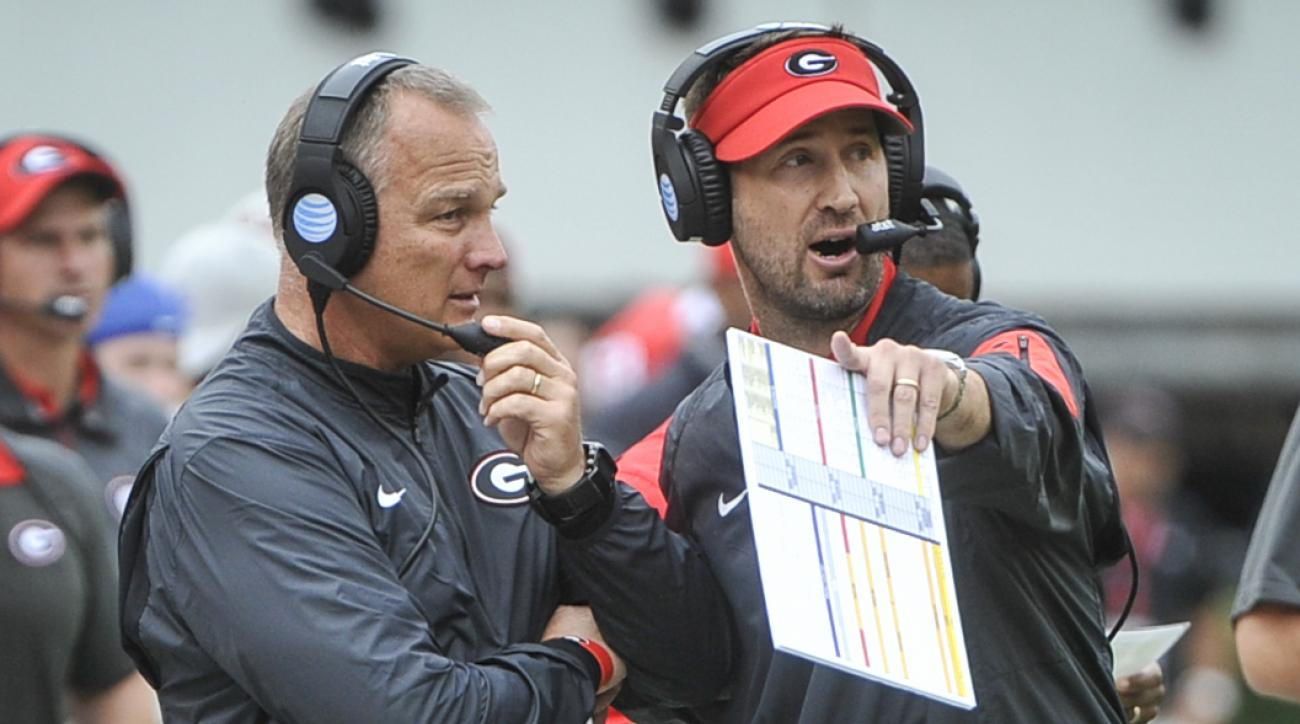 Georgia head coach Mark Richt, left, talks on the sideline to offensive coordinator Brian Schottenheimer during the first half of an NCAA college football game against Kentucky, Saturday, Nov. 7, 2015, in Athens, Ga. (AP Photo/John Amis)