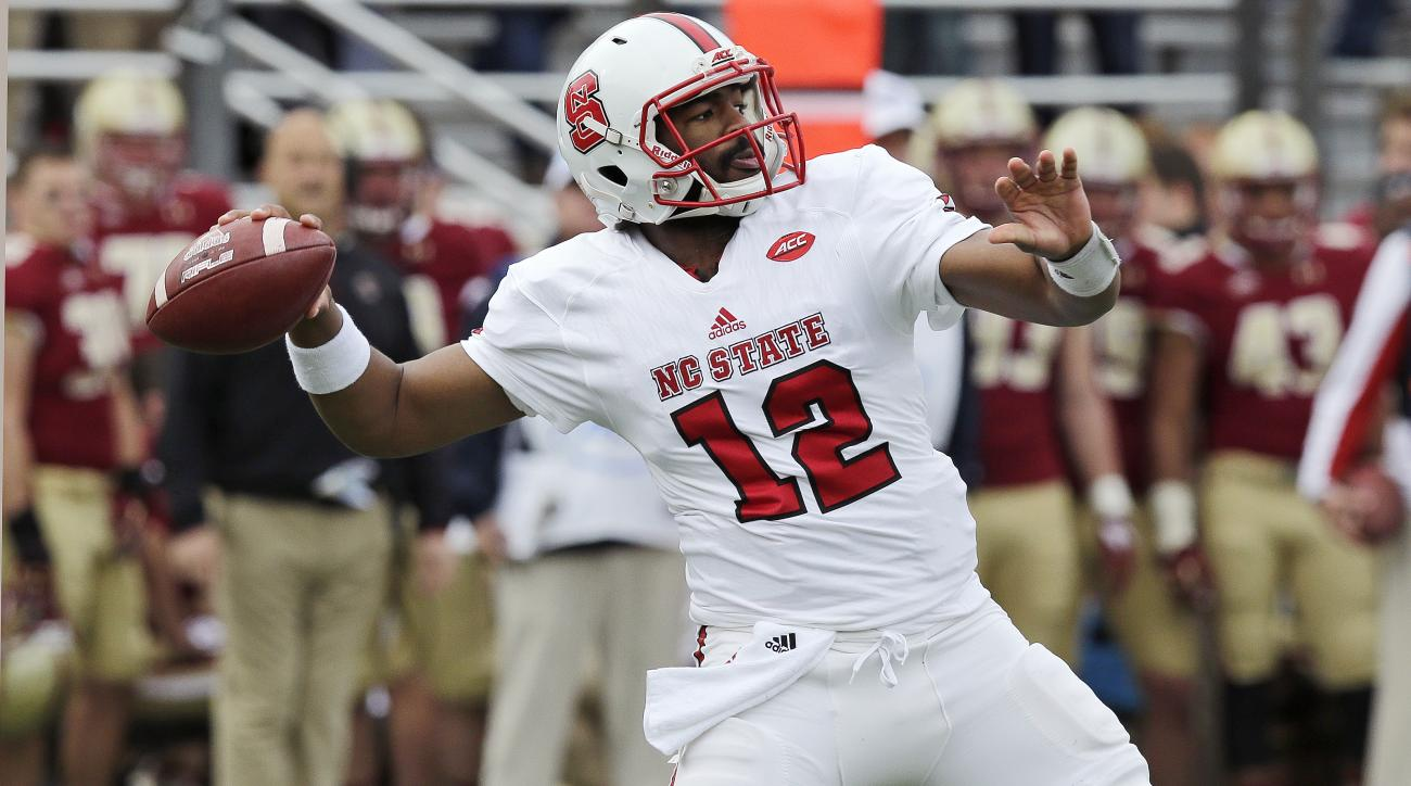 North Carolina State quarterback Jacoby Brissett (12) throws against Boston College during the first half of an NCAA college football game in Boston, Saturday, Nov. 7, 2015. (AP Photo/Charles Krupa)