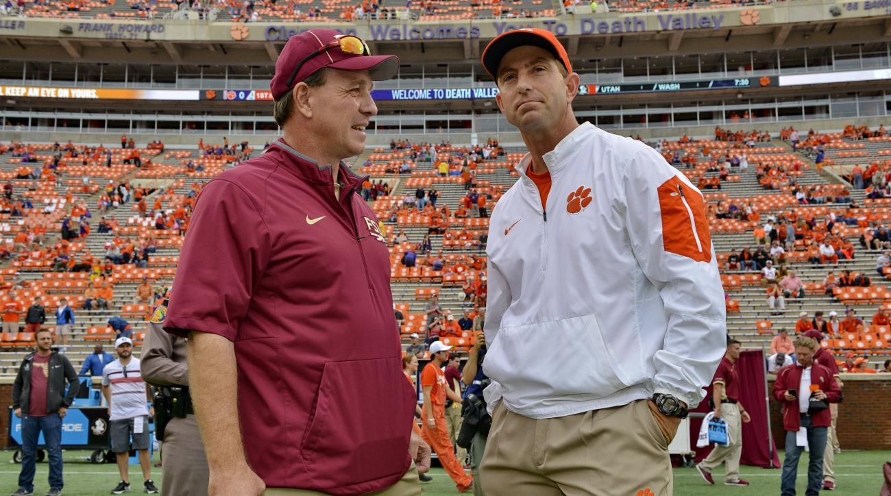 Florida State head coach Jimbo Fisher, left, and Clemson head coach Dabo Swinney talk before the start of an NCAA college football game Saturday, Nov. 7, 2015,  in Clemson,  S.C.  (AP Photo/Richard Shiro)