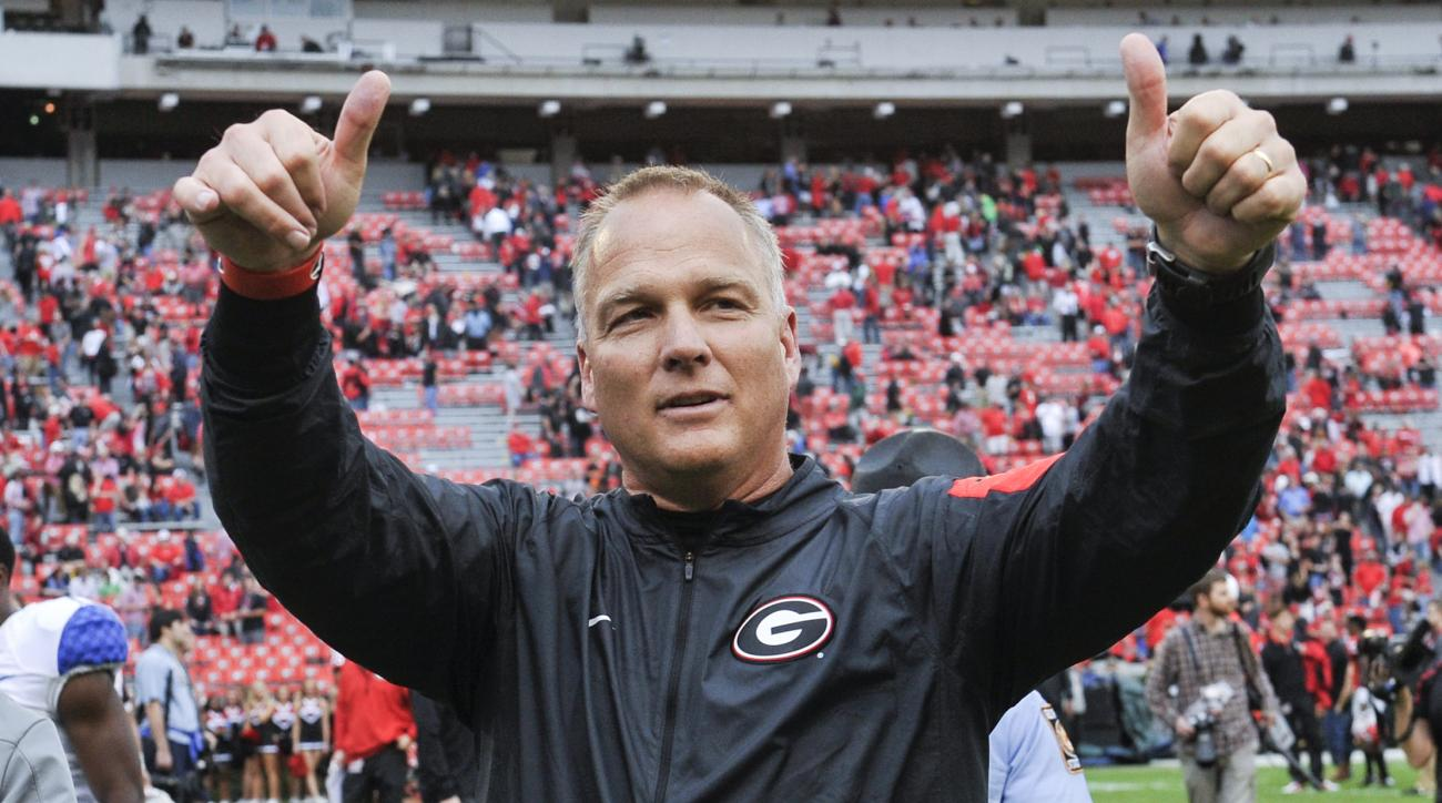 Georgia head coach Mark Richt gives a thumbs up to the crowd as he walks off the field after an NCAA college football game against Kentucky, Saturday, Nov. 7, 2015, in Athens, Ga. Georgia won 27-3. (AP Photo/John Amis)