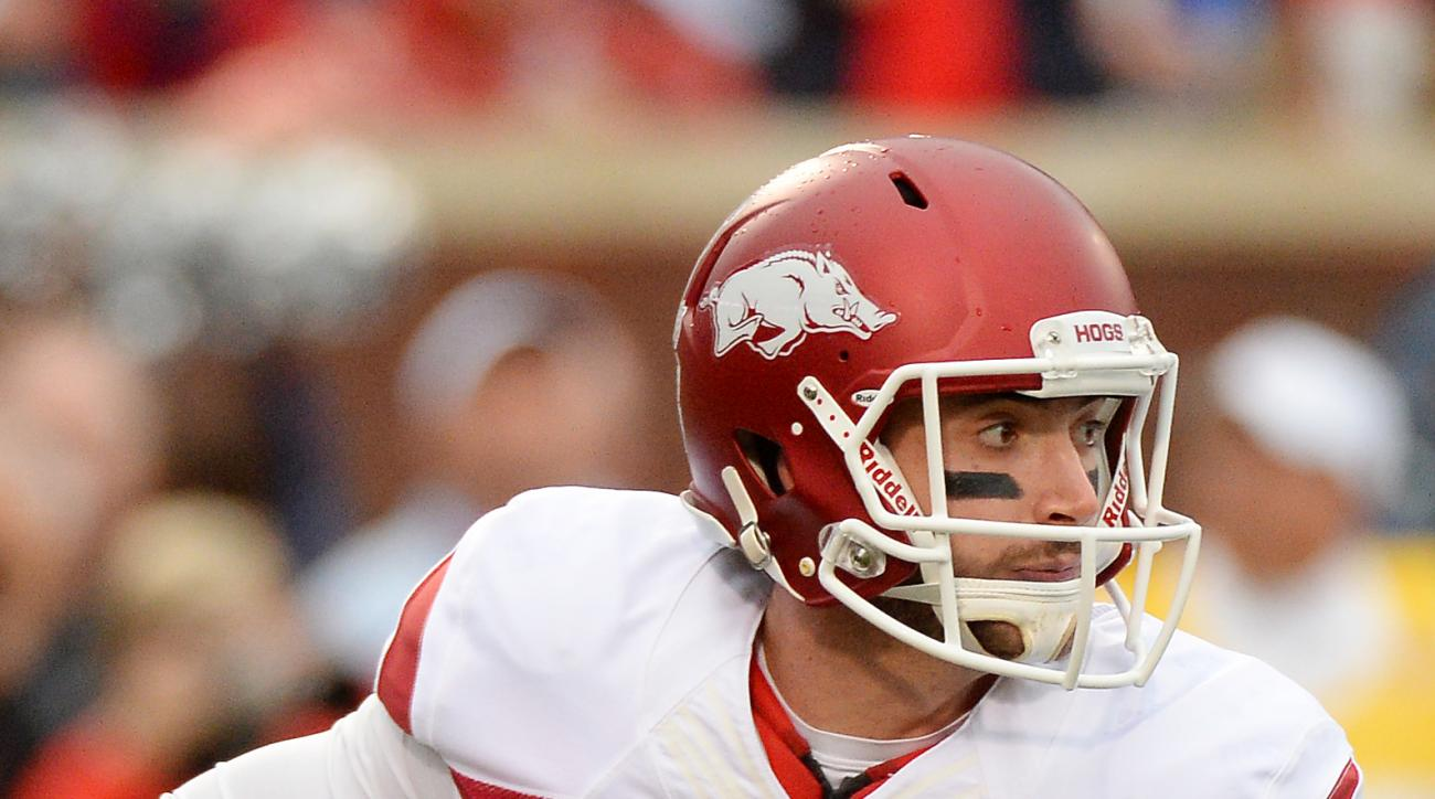 Arkansas quarterback Brandon Allen (10) looks to pass during the first quarter of an NCAA college football game against Mississippi in Oxford, Miss., Saturday, Nov. 7, 2015. (AP Photo/Thomas Graning)