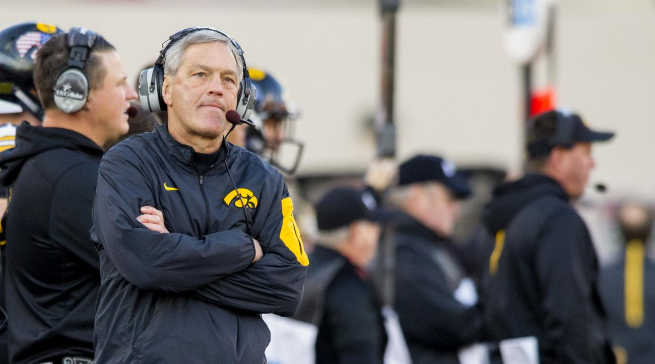 Iowa head coach Kirk Ferentz reacts after the team was called for holding against Indiana during the first half of an NCAA college football game in Bloomington, Ind., Saturday, Nov. 7, 2015. (AP Photo/Doug McSchooler)