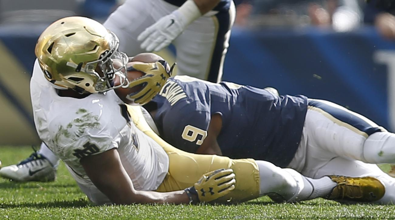 Notre Dame running back C.J. Prosise (20) is tackled by Pittsburgh defensive back Jordan Whitehead (9) in the first quarter of an NCAA football game, Saturday, Nov. 7, 2015 in Pittsburgh. Prosise was injured later in the game and did not return. (AP Photo