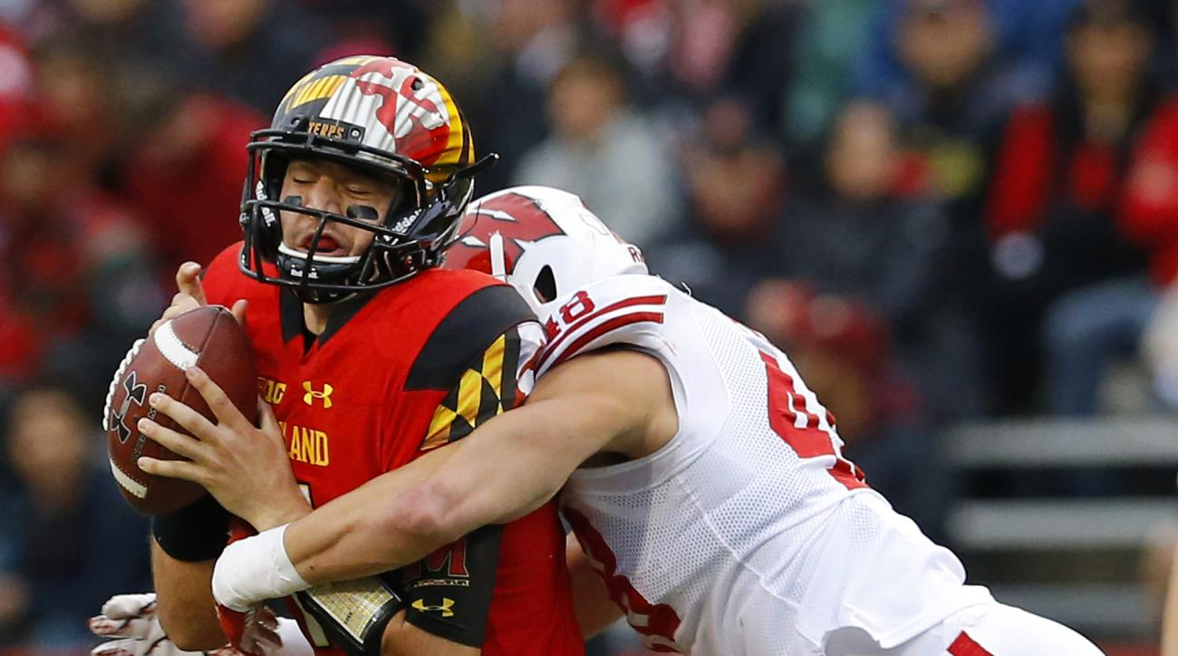 Maryland quarterback Perry Hills, left, is sacked by Wisconsin linebacker Jack Cichy in the first half of an NCAA college football game, Saturday, Nov. 7, 2015, in College Park, Md. (AP Photo/Patrick Semansky)