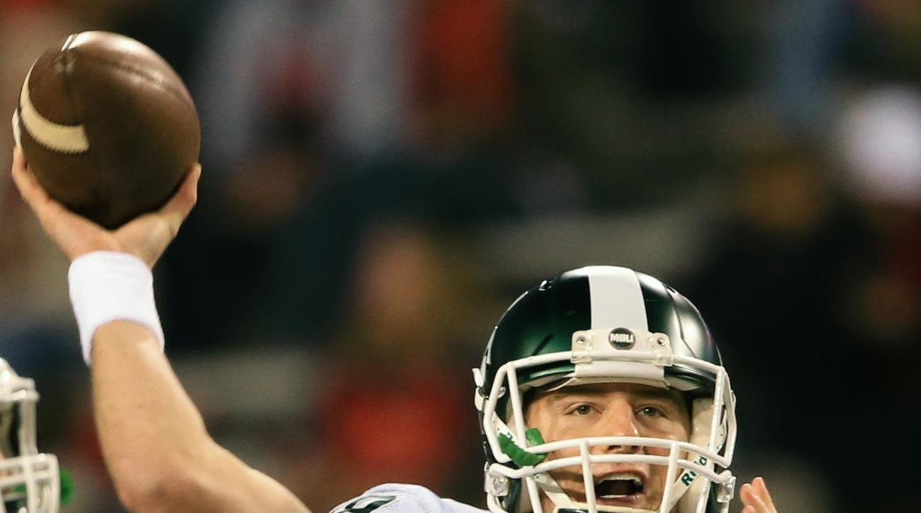 Michigan State quarterback Connor Cook (18) throws before an NCAA college football game against Nebraska in Lincoln, Neb., Saturday, Nov. 7, 2015. (AP Photo/Nati Harnik)