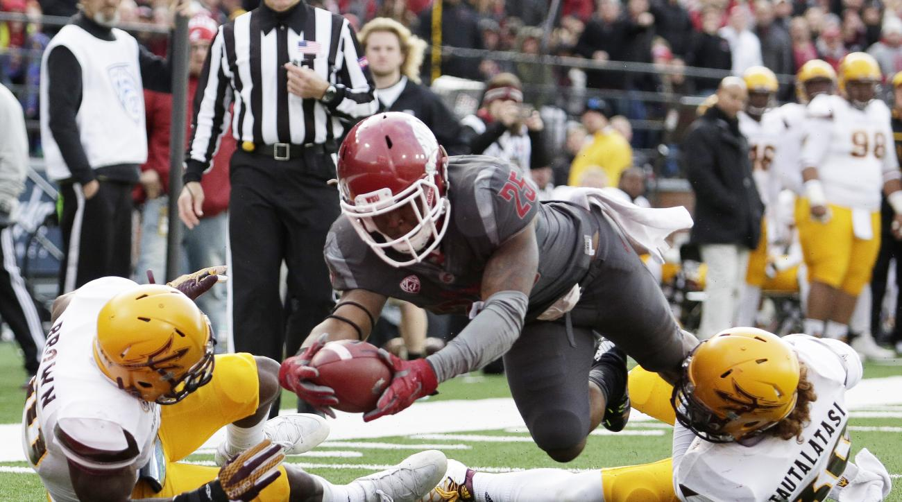 Washington State running back Jamal Morrow (25) dives for a touchdown between Arizona State defensive back Kweishi Brown, left, and defensive back Dasmond Tautalatasi during the second half of an NCAA college football game, Saturday, Nov. 7, 2015, in Pull
