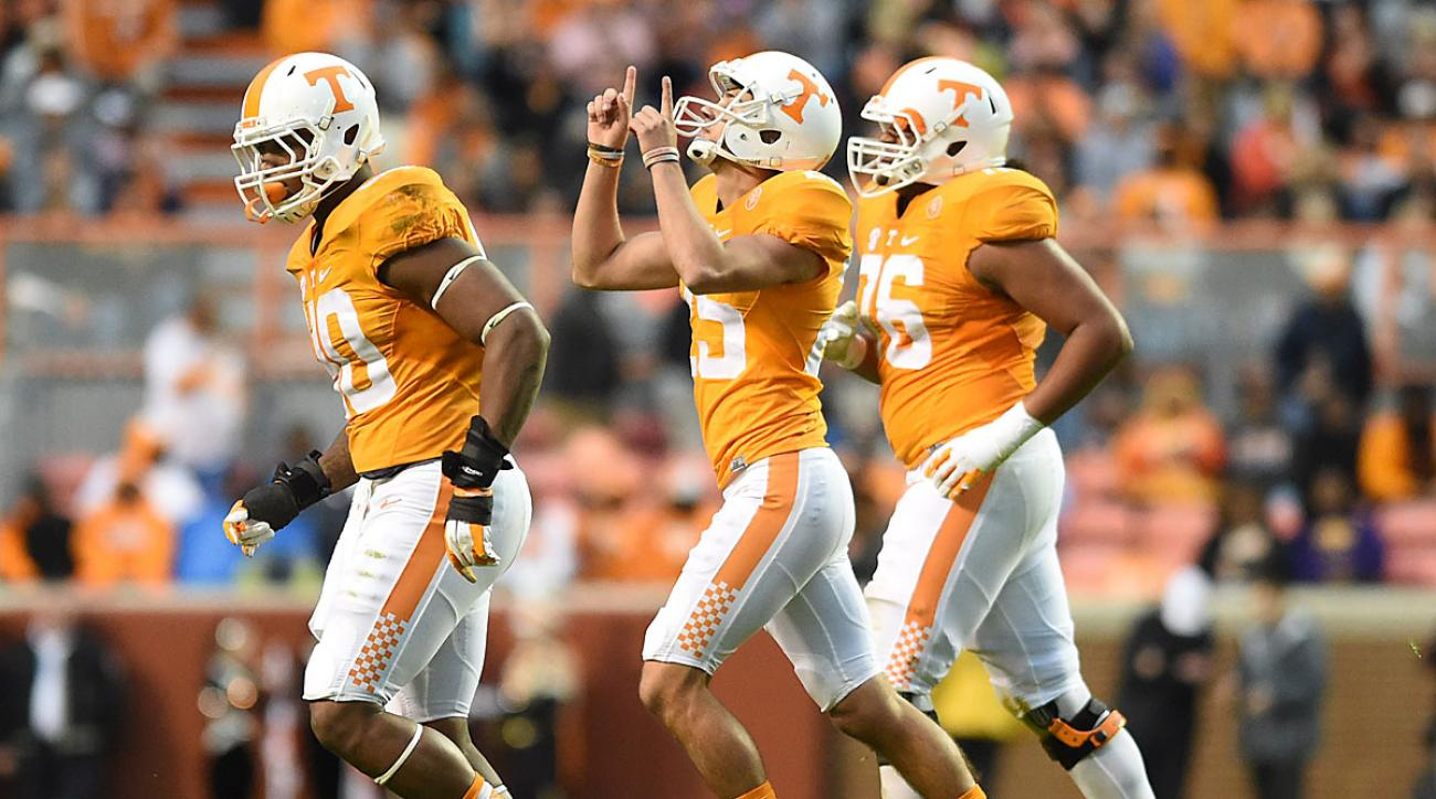 Tennessee's Aaron Medley (25), center, celebrates kicking a field goal against South Carolina during the first half of an NCAA college football game at Neyland Stadium in Knoxville, Tenn. on Saturday, Nov. 7, 2015. (Adam Lau/Knoxville News Sentinel via AP