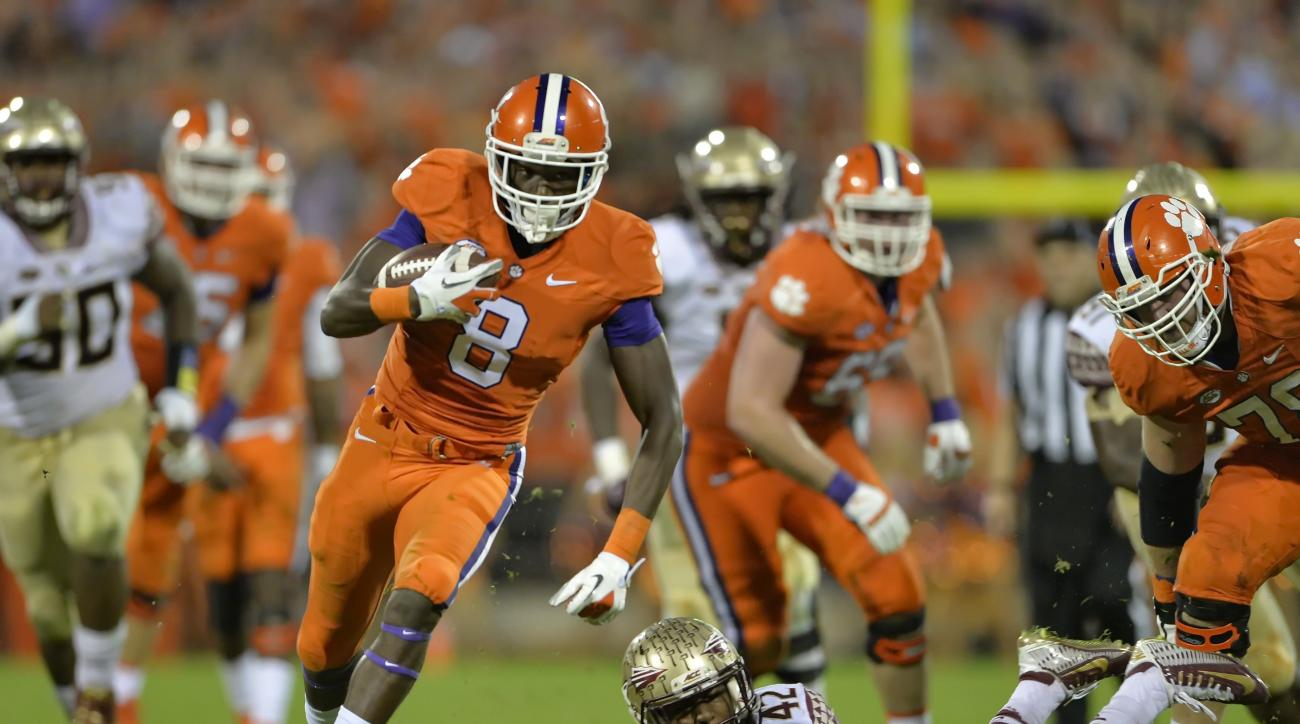 Clemson's Deon Cain (8) rushes out of the tackle attempt by Florida State's Lamarcus Brutus on his way to a touchdown during the second half of an NCAA college football game Saturday, Nov. 7, 2015,  in Clemson,  S.C.  Clemson won 23-13. (AP Photo/Richard
