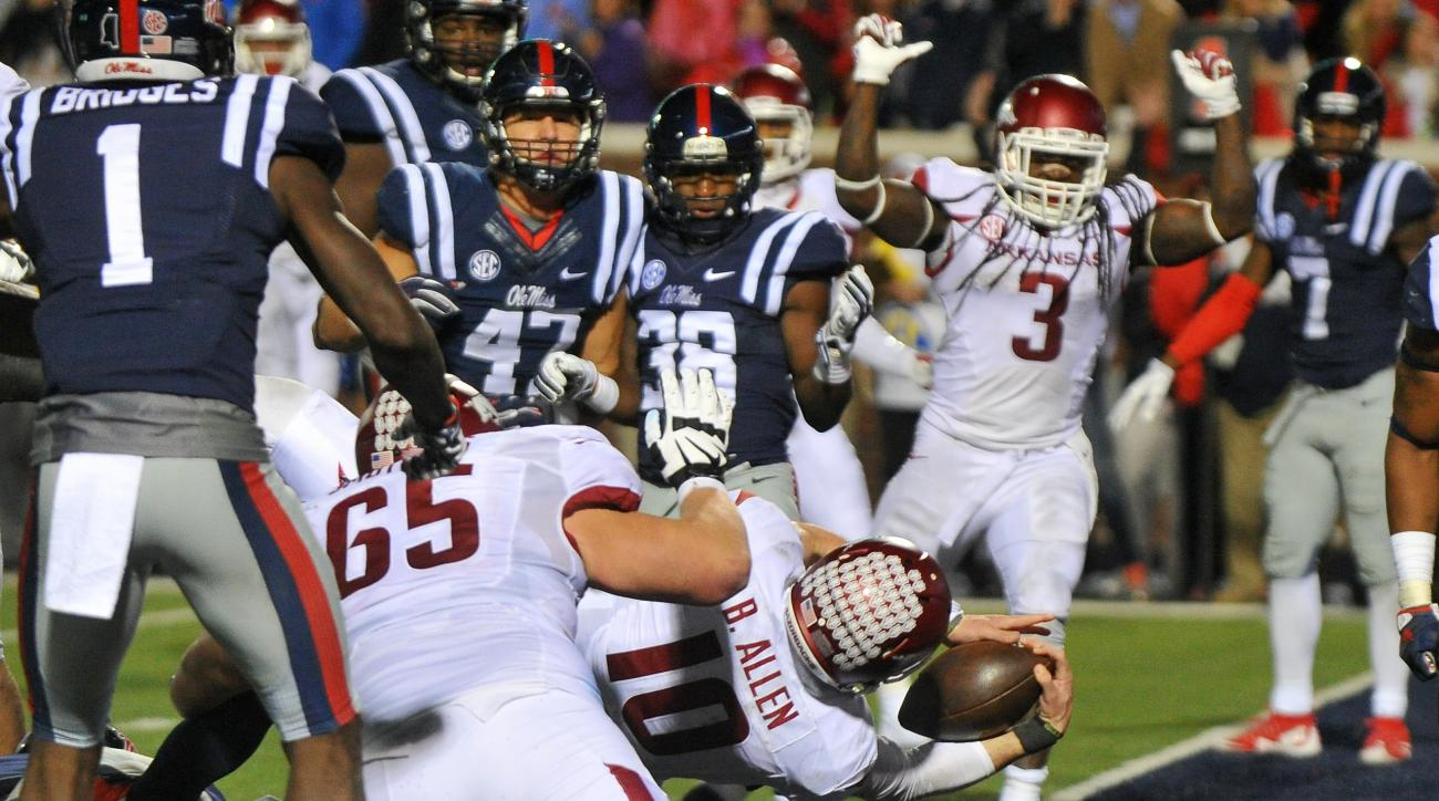 Arkansas quarterback Brandon Allen (10) dives in to the end zone for a 2-point conversion during overtime of an NCAA college football game against Mississippi in Oxford, Miss., Saturday, Nov. 7, 2015. Arkansas won 53-52 in overtime. (AP Photo/Thomas Grani