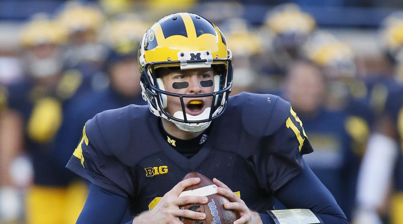 Michigan quarterback Jake Rudock looks to pass against Rutgers during the first half of an NCAA college football game Saturday, Nov. 7, 2015, in Ann Arbor, Mich. Rudock threw for two touchdowns and a career-high 337 yards in a 49-16 win over Rutgers. (AP