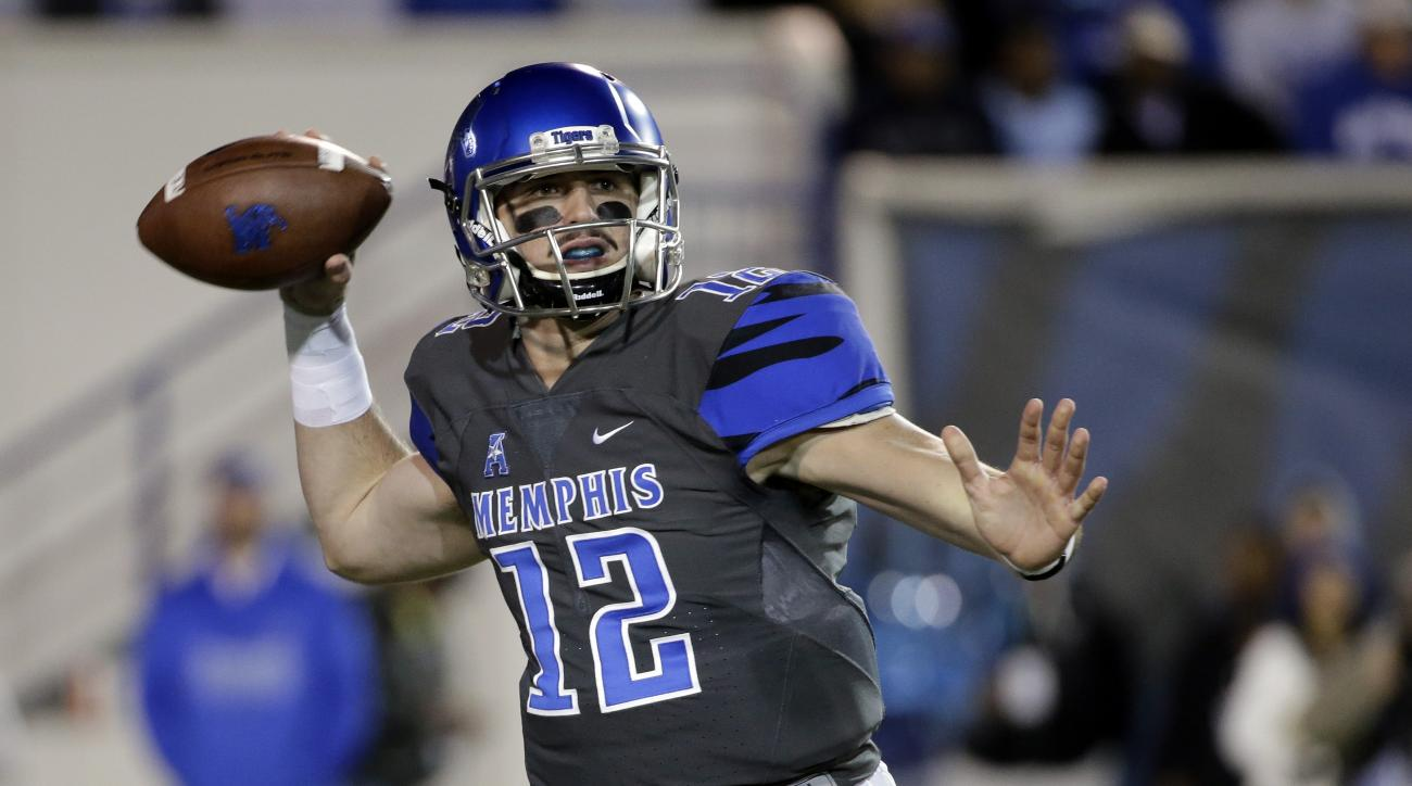 Memphis quarterback Paxton Lynch (12) passes against Navy in the first half of an NCAA college football game Saturday, Nov. 7, 2015, in Memphis, Tenn. (AP Photo/Mark Humphrey)
