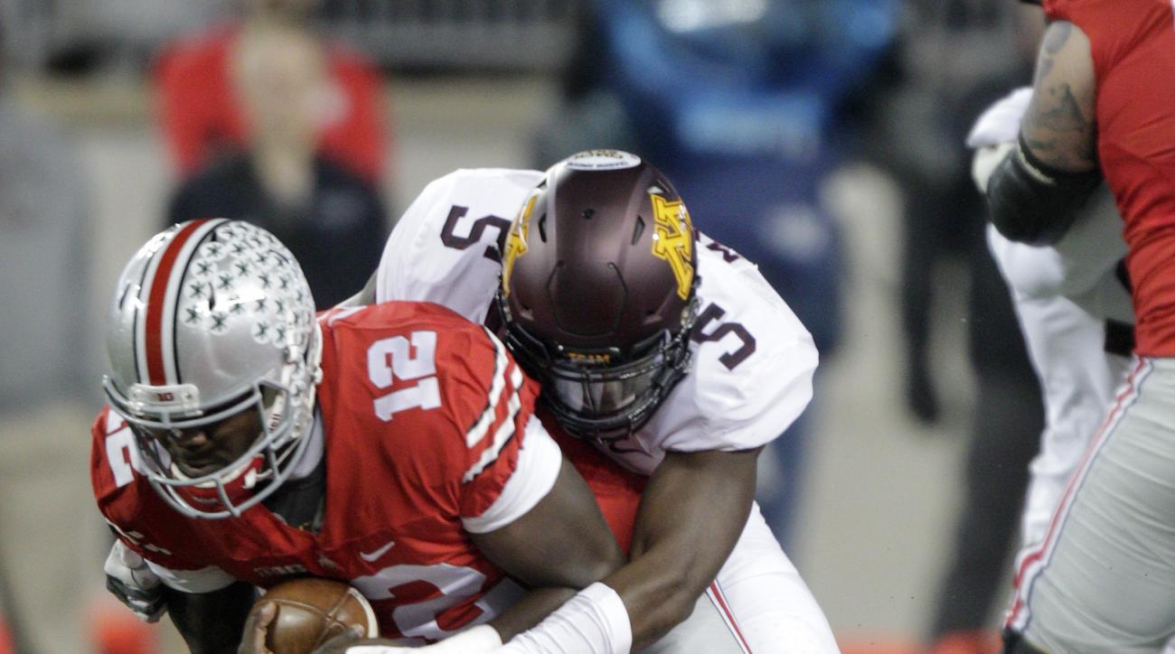 Minnesota cornerback Jalen Myrick, top, sacks Ohio State quarterback Cardale Jones during the first quarter of an NCAA college football game Saturday, Nov. 7, 2015, in Columbus, Ohio. (AP Photo/Jay LaPrete)