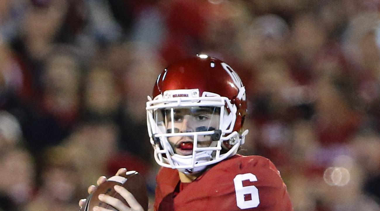 Oklahoma quarterback Baker Mayfield looks to pass against Iowa State during the first quarter of an NCAA college football game in Norman, Okla., on Saturday, Nov. 7, 2015. (AP Photo/Alonzo Adams)