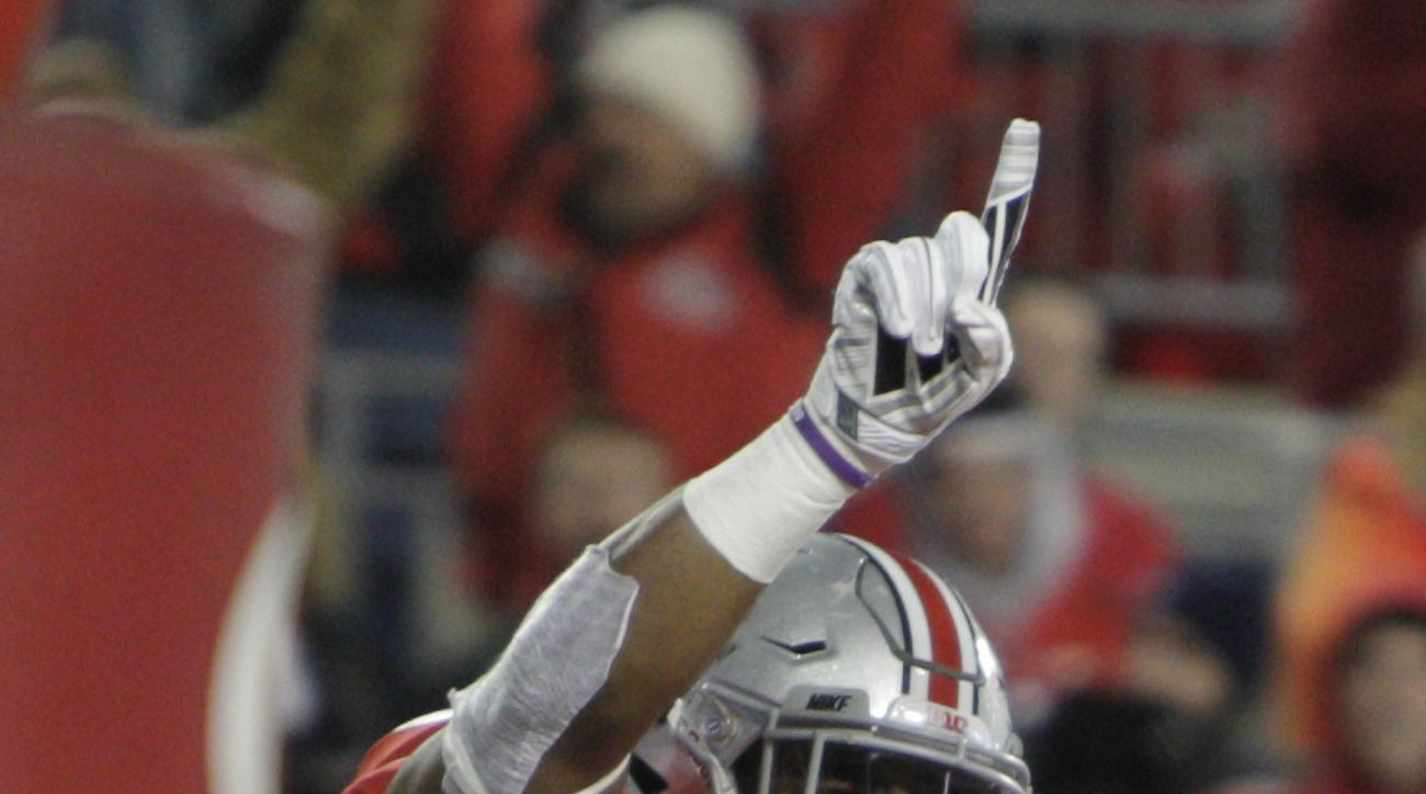 Ohio State running back Ezekiel Elliott, top, celebrates his touchdown against Minnesota with teammate Chase Farris during the second quarter of an NCAA college football game Saturday, Nov. 7, 2015, in Columbus, Ohio. (AP Photo/Jay LaPrete)