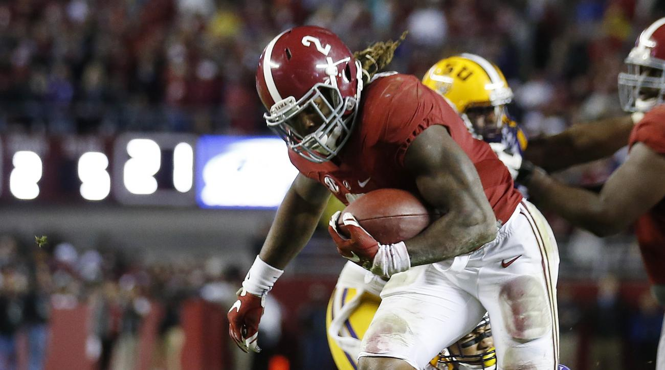 Alabama running back Derrick Henry (2) is hit by LSU linebacker Duke Riley (40) in the second half of an NCAA college football game Saturday, Nov. 7, 2015, in Tuscaloosa , Ala. (AP Photo/John Bazemore)