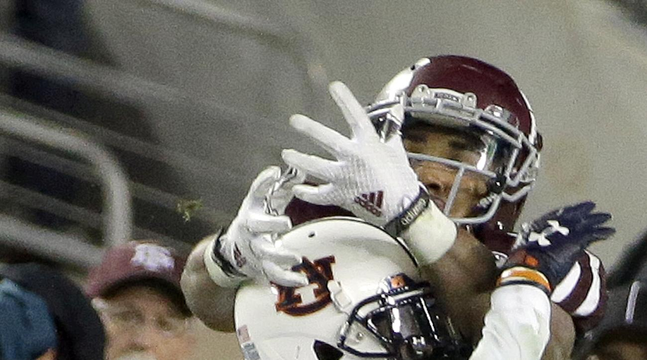 Auburn defensive back Stephen Roberts (14) breaks up a pass intended for Texas A&M wide receiver Christian Kirk during the second half of an NCAA college football game Saturday, Nov. 7, 2015, in College Station, Texas. Auburn won 26-10. (AP Photo/David J.