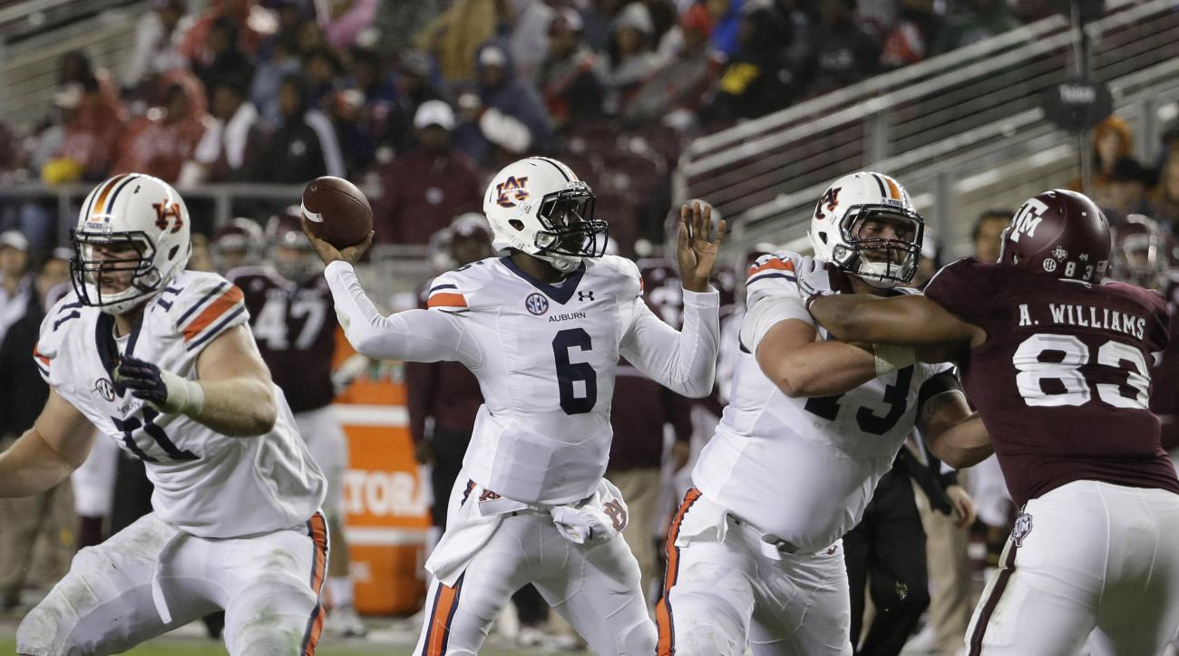 Auburn quarterback Jeremy Johnson (6) throws a pass against Texas A&M during the second half of an NCAA college football game, Saturday, Nov. 7, 2015, in College Station, Texas. Auburn won 26-10. (AP Photo/David J. Phillip)