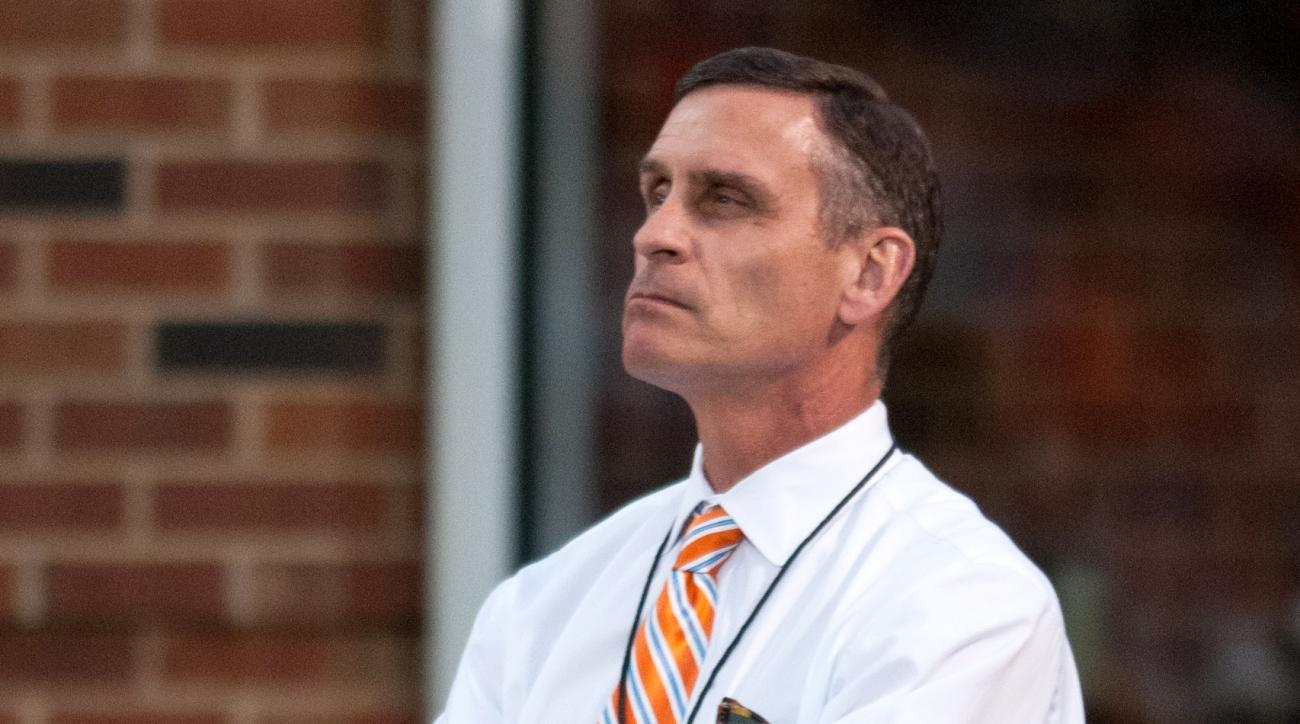 FILE - In this Sept. 26, 2015, file photo, Illinois athletic director Mike Thomas watches an NCAA football game against Middle Tennessee in Champaign, Ill. Illinois fired athletic director Mike Thomas on Monday, Nov. 9, 2015, as it prepares to release the