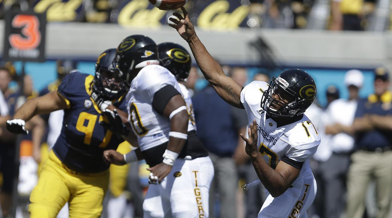 Grambling State's Johnathan Williams passes against California during the first half of an NCAA college football game Saturday, Sept. 5, 2015, in Berkeley, Calif. (AP Photo/Ben Margot)