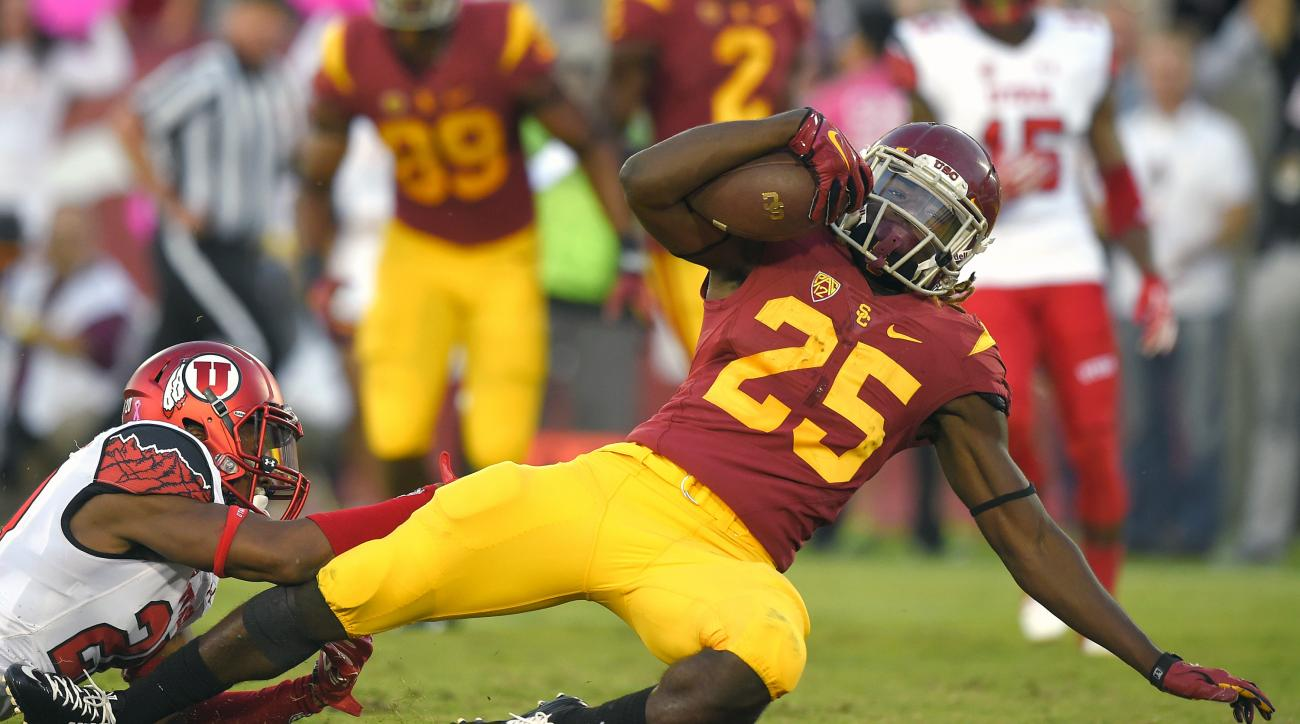 FILE - This Saturday, Oct. 24, 2015,  file photo shows Southern California running back Ronald Jones II, right, getting past Utah defensive back Marcus Williams during the first half of an NCAA college football game in Los Angeles. Although Jones is still