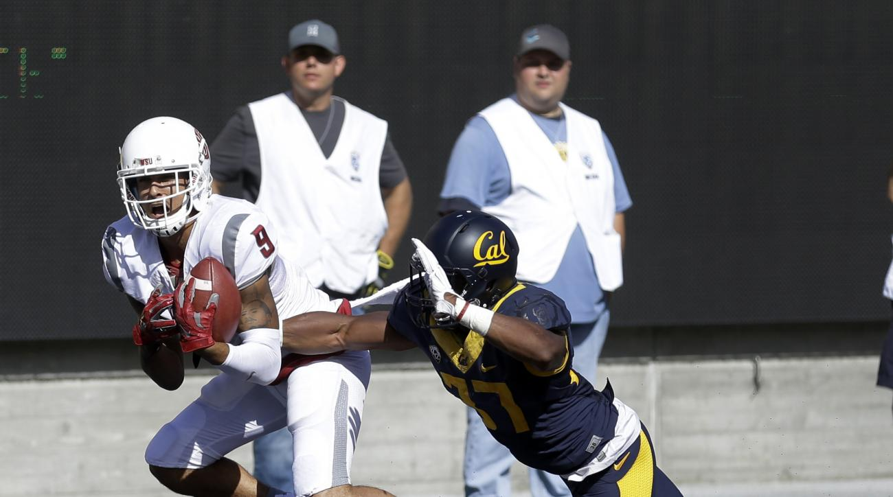 FILE - In this Oct. 3, 2015, file photo, Washington State's Gabe Marks, left, makes a touchdown reception past California's Cedric Dozier during the second half of an NCAA college football game, in Berkeley, Calif. Marks, a junior who redshirted last seas