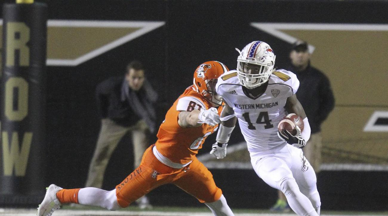 Western Michigan's Darius Phillips (14) carries against Bowling Green during an NCAA college football game Wednesday night, Nov. 11, 2015, in Kalamazoo, Mich. (Daytona Niles/The Gazette via AP