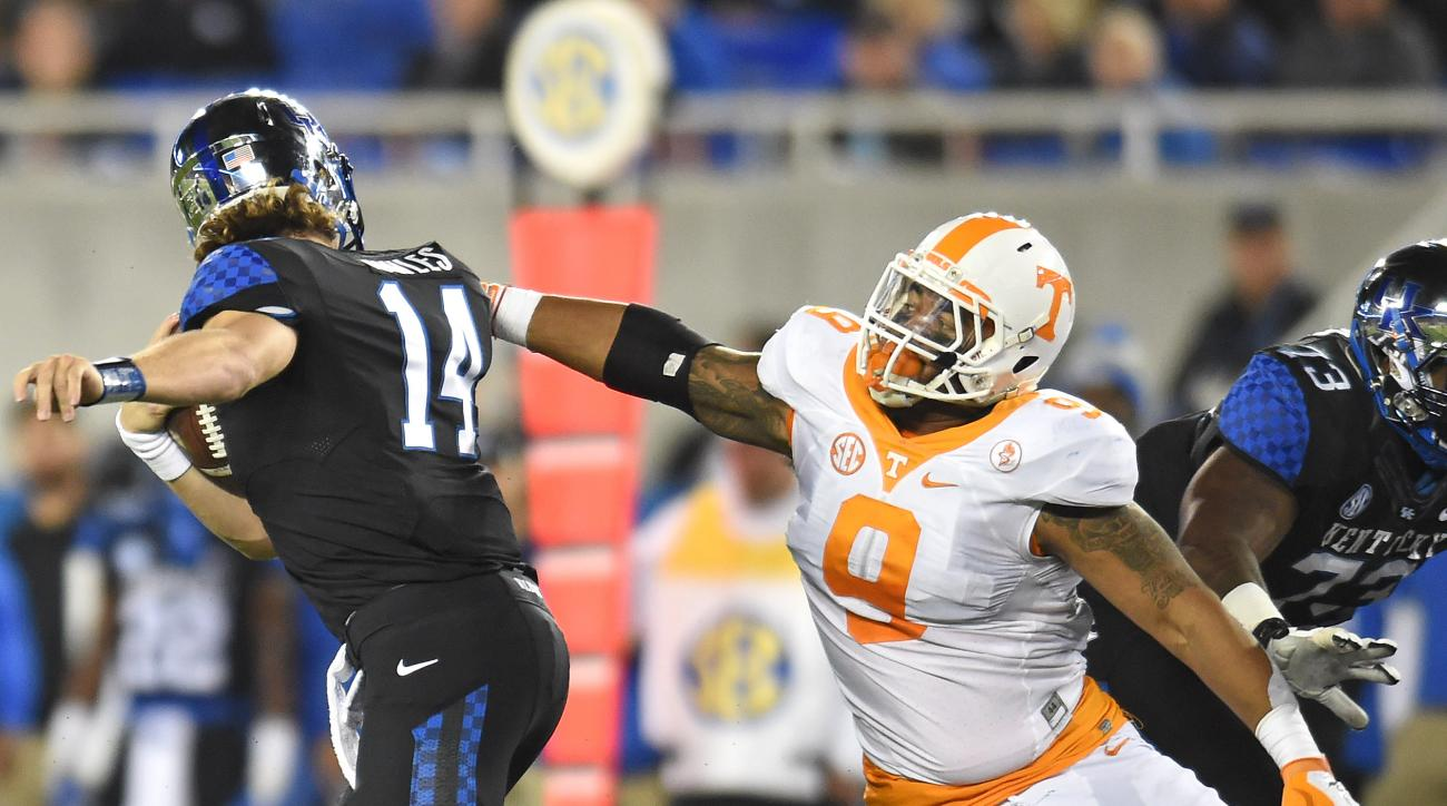 In this Oct. 31, 2015, file photo, Tennessee defensive end Derek Barnett sacks Kentucky quarterback Patrick Towles during an NCAA college football game in Lexington, Ky. After recording just one sack in Tennessee's first five games, Barnett has five sacks