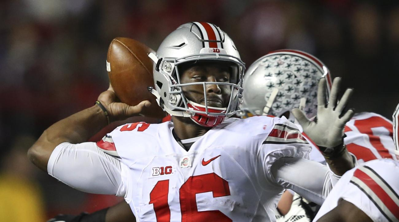 FILE - In this Oct. 24, 2015, file photo, Ohio State quarterback J.T. Barrett (16) throws a pass during an NCAA college football game against Rutgers, in Piscataway, N.J. Barrett initially told a Columbus police officer he hadn't been drinking the night h
