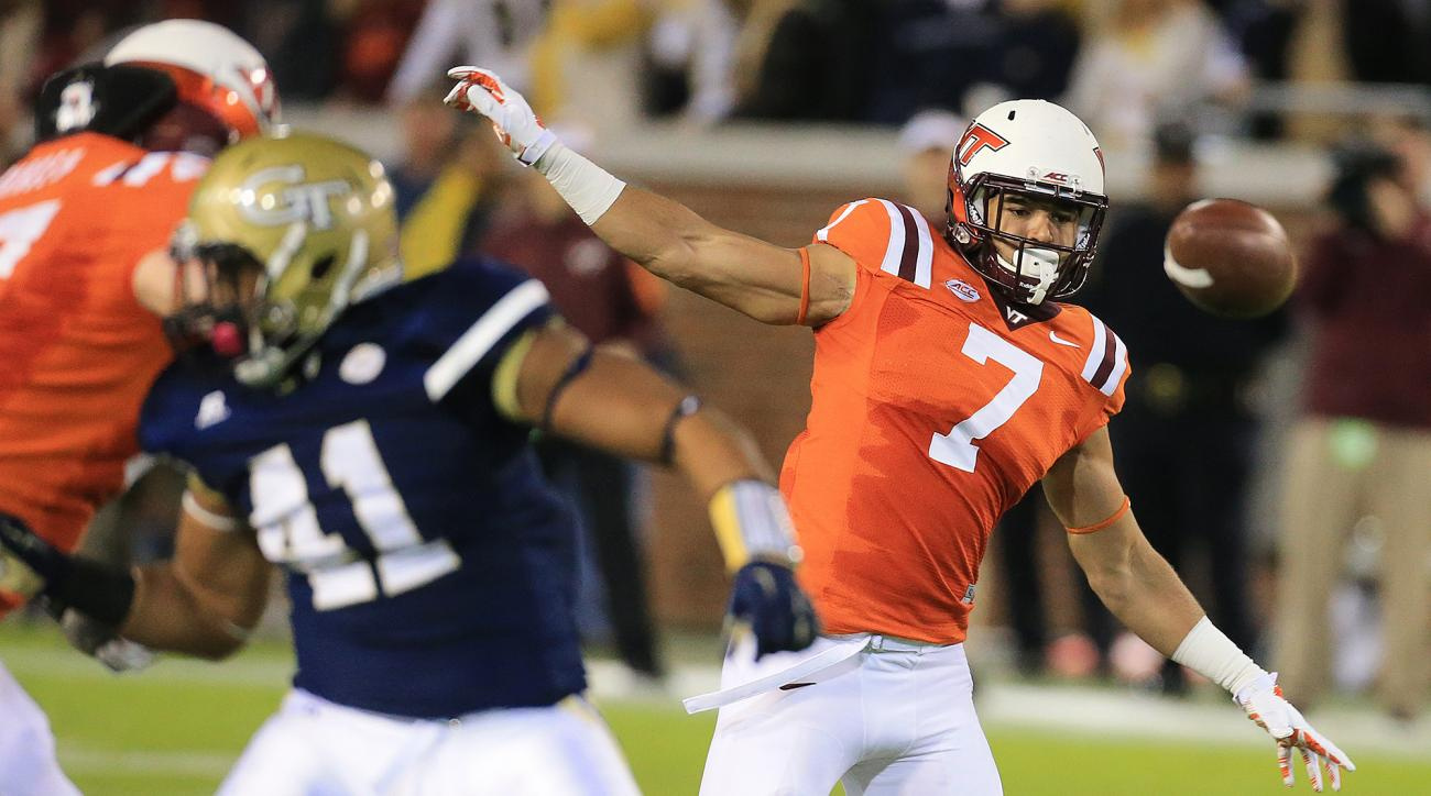 Georgia Tech defender Rod Rook-Chungong tips a pass at the line of scrimmage for an incomplete pass to Virginia Tech tight end Bucky Hodges during the first quarter of an NCAA college football game Thursday, Nov. 12, 2015, in Atlanta. (Curtis Compton/Atla