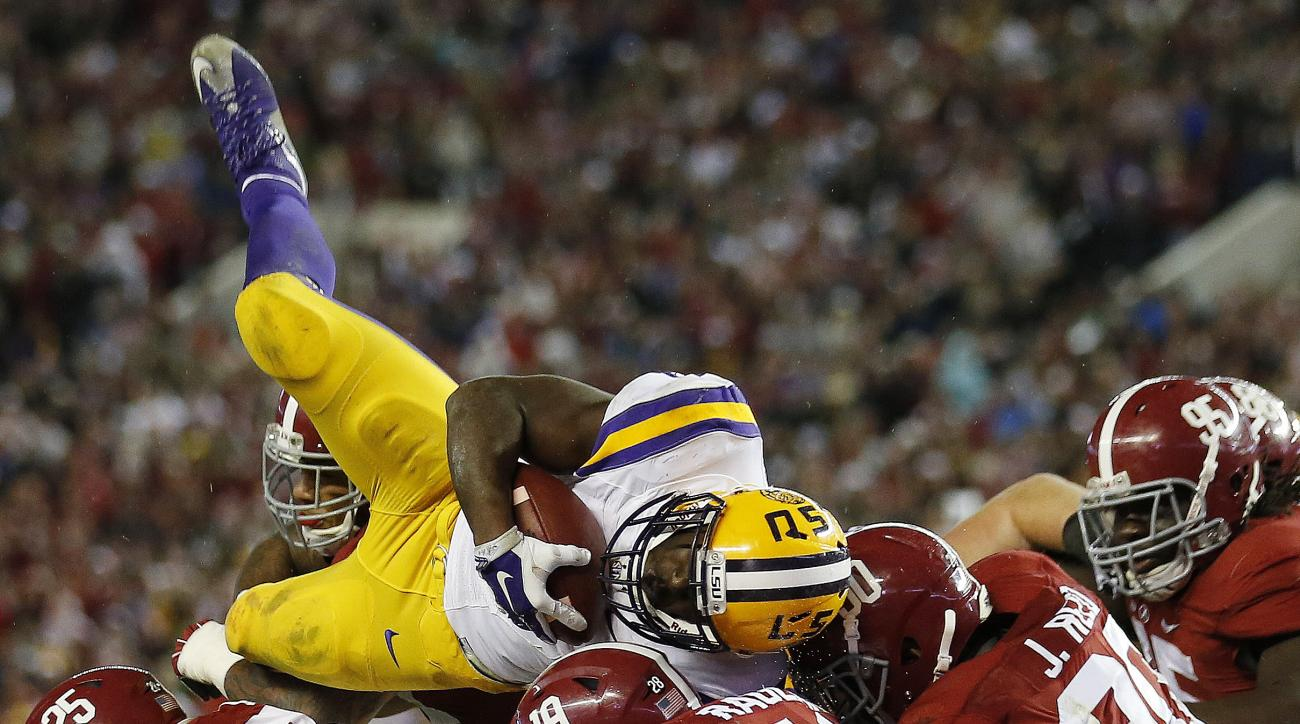 FILE - In this Nov. 7, 2015, file photo, LSU running back Leonard Fournette (7) tries to reach the end zone as the Alabama defense holds at the line in the second half of an NCAA college football game in Tuscaloosa, Ala. The Heisman Trophy race gets real