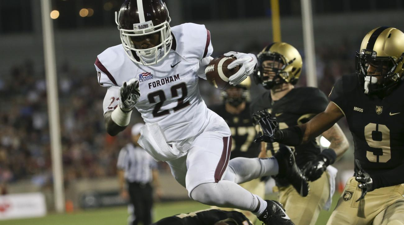 Fordham running back Chase Edmonds (22) scores a touchdown during the first half of an NCAA college football game against Army on Friday, Sept. 4, 2015, in West Point, N.Y. (AP Photo/Mike Groll)