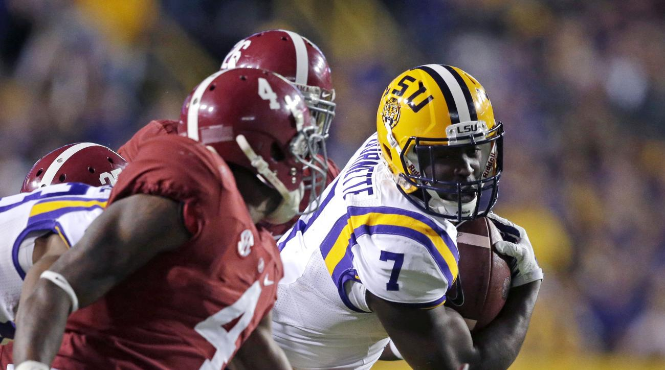 FILE - In this Nov. 8, 2014, file photo, LSU running back Leonard Fournette (7) carries in the first half of an NCAA college football game against Alabama in Baton Rouge, La. If all goes right for Fournette this weekend, he will turn attention back to his