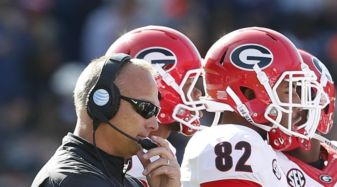 Georgia head coach Mark Richt listens in as coaches talk to players in a timeout during the second quarter of an NCAA football game, Saturday against Auburn, Nov. 14, 2015, in Auburn, Ala. (AP Photo/Butch Dill)