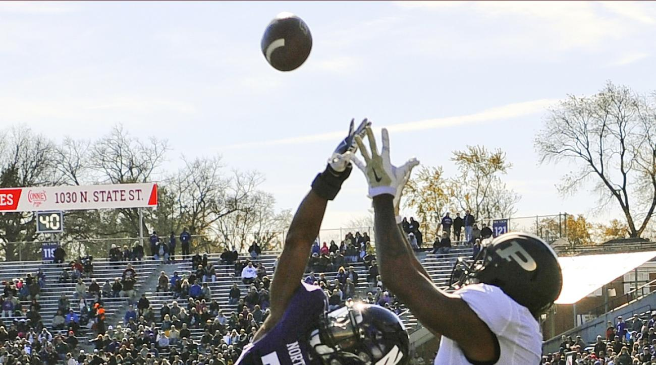 Northwestern Wildcats cornerback Matthew Harris (27) breaks up a pass in the end zone intended for Purdue  wide receiver DeAngelo Yancey (7) during the first half of an NCAA college football game in Evanston, Ill.,  Saturday, Nov. 14, 2015. (AP Photo/Matt