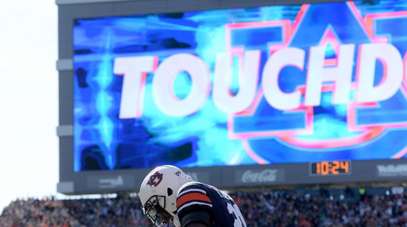 Auburn running back Kerryon Johnson (21) celebrates a touchdown against Georgia during the first half  of an NCAA college football game,Saturday, Nov. 14, 2015, at Jordan-Hare Stadium in Auburn, Ala. (Julie Bennett/AL.com via AP) MAGS OUT; MANDATORY CREDI