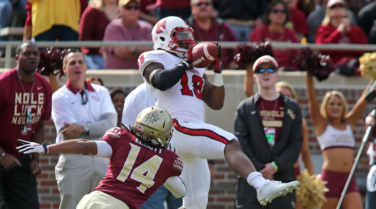 North Carolina State's Bra'Lon Cherry makes a reception as Florida State's Javien Elliot closes in for the tackle in the first quarter of an NCAA college football game, Saturday, Nov. 14, 2015 in Tallahassee, Fla. (AP Photo/Steve Cannon)