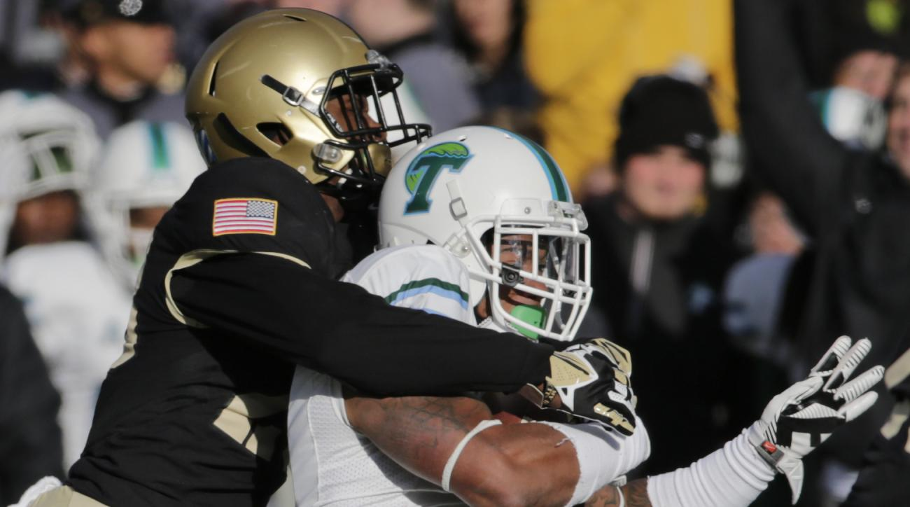 Tulane running back Sherman Badie (3) is tackled by Army cornerback Brandon Jackson (28) during the second half of an NCAA college football game on Saturday, Nov. 14, 2015, in West Point, N.Y. Tulane won 34-31. (AP Photo/Mike Groll)