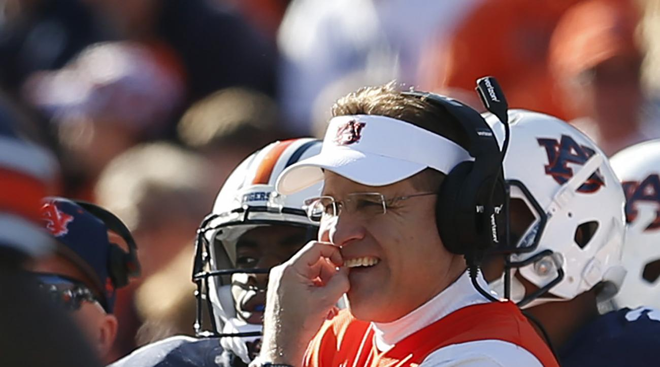 Auburn head coach Gus Malzahn waits for the replay official on a fumble loss to Georgia during the second half of an NCAA football game, Saturday, Nov. 14, 2015, in Auburn, Ala. Georgia won 20-13. (AP Photo/Butch Dill)