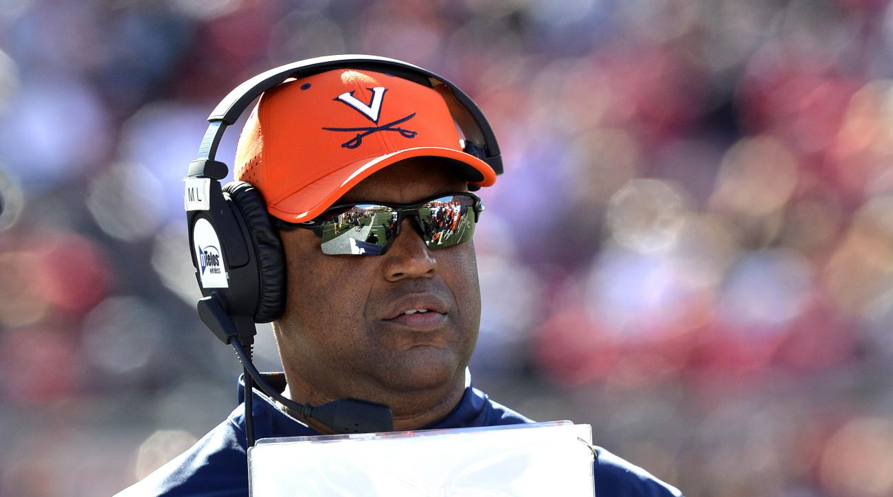 Virginia head football coach Mike London watches his team during the first half of an NCAA college football game against Louisville, Saturday, Nov. 14, 2015, in Louisville, Ky. (AP Photo/Timothy D. Easley)