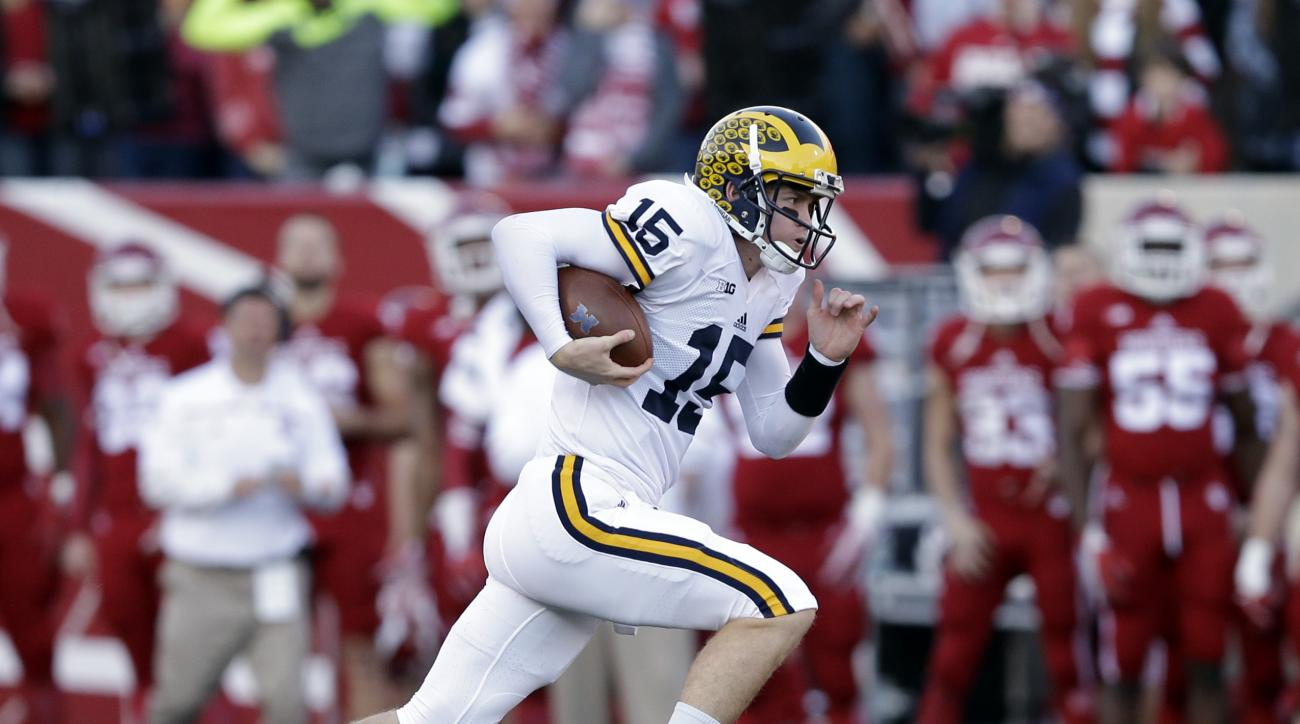 Michigan's Jake Rudock runs during the first half of an NCAA college football game against Indiana, Saturday, Nov. 14, 2015, in Bloomington, Ind. (AP Photo/Darron Cummings)