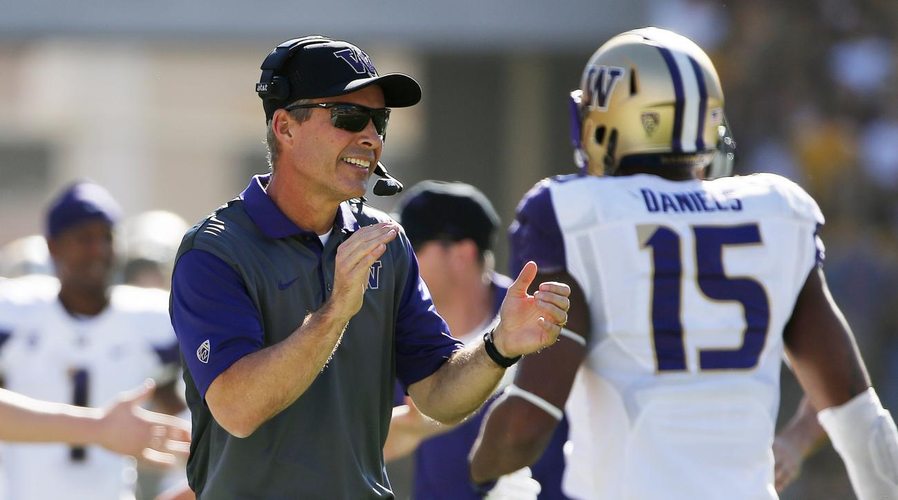 Washington head coach Chris Petersen applauds his players after a touchdown against Arizona State during the first half of an NCAA college football game Saturday, Nov. 14, 2015, in Tempe, Ariz. (AP Photo/Ross D. Franklin)